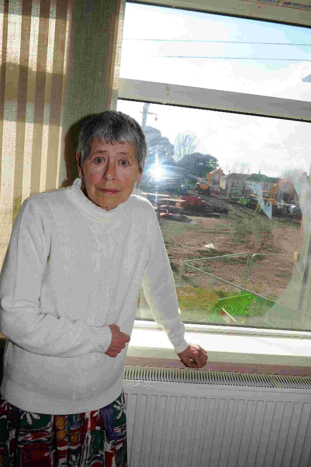 Widow tells of 'year of hell' as flats are demolished