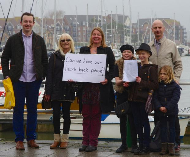 SUPPORT: Clare Sutton, centre, hands in the Castle Cove petition with local Green Party members and residents