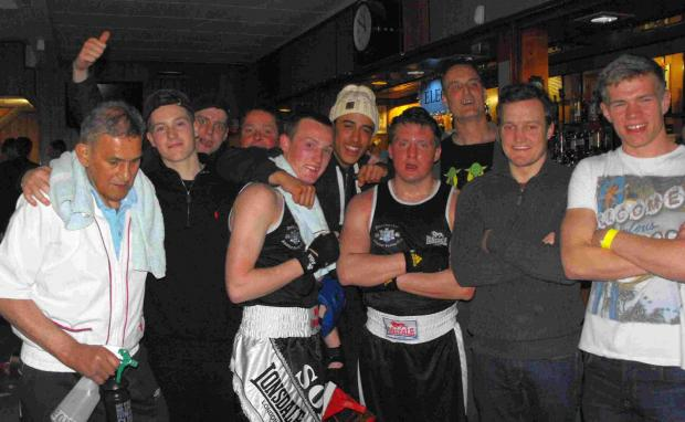 SHOWTIME: Dorchester boxers with coach Ben Geyser, left