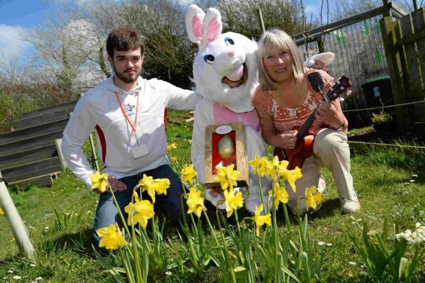 Dorset Echo: HAVING A BALL: Aaron Mallon and Jan Morgan with the Easter bunny