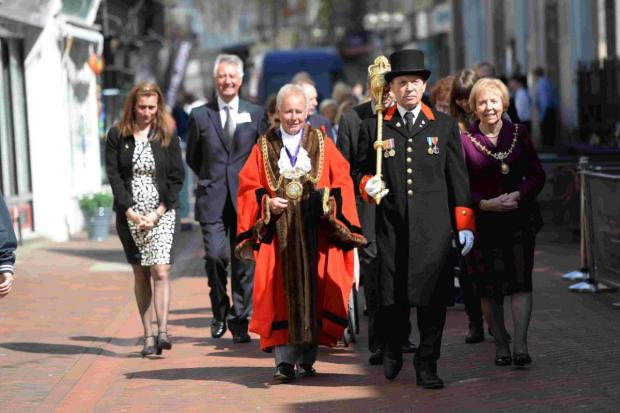 CEREMONIAL: The Mayor Ray Banham leads the Sir Samuel Mico Trust parade from St Mary's Church to The George Inn