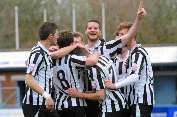MAGPIES' JOY: Nathan Walker, centre, leads the celebrations after Mark Jermyn's goal