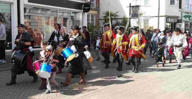 Dorset Echo: WATCH OUT: Pirates and smugglers parade through Weymouth town centre