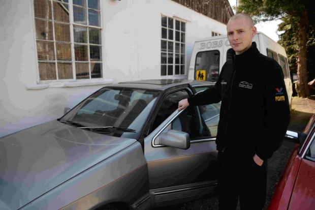 DAMAGE: Ben Galloway manager at Poundbury Garage has had trouble with vandalism