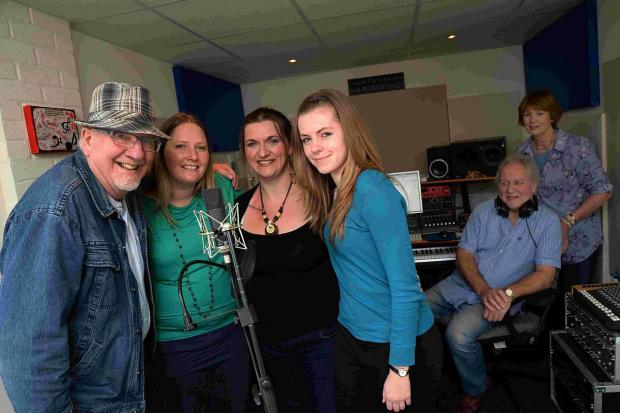 FINE VOICE: Bridport singers, from left, Stuart Laslie, Karen Warren, Kerry Gould and Amy Tribe with Eddie Adamberry and Heather Hamer