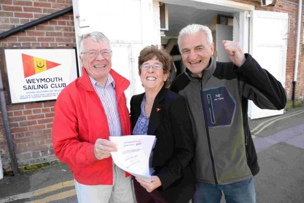 boost: Weymouth Sailing Club celebrate their National Lottery grant, from left, Phil Gray, Kathie Claydon and Ray Capp