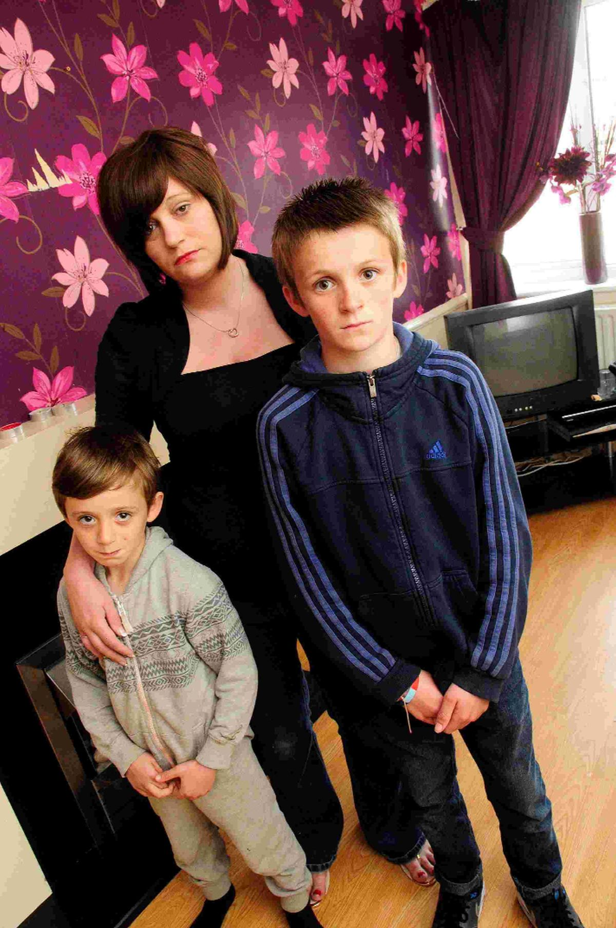 VICTIMS: Michelle Rainford with two of her children Kyle and Declan Harvey