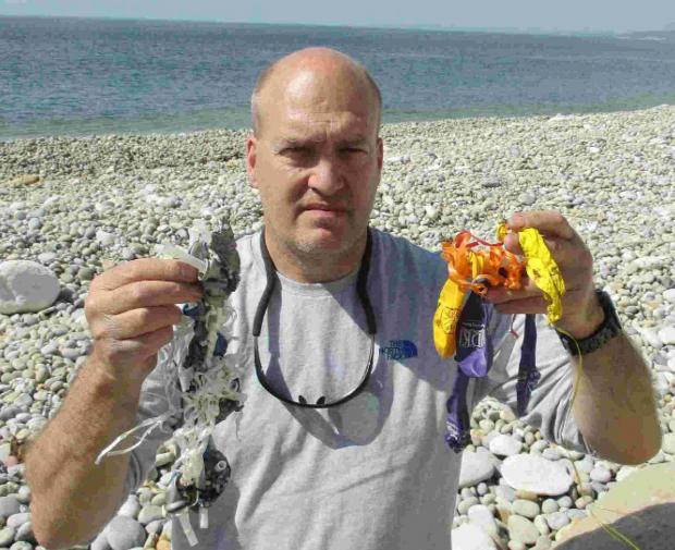 DEBRIS: Steve Trewhella with balloons he has picked up over the years from Dorset beaches