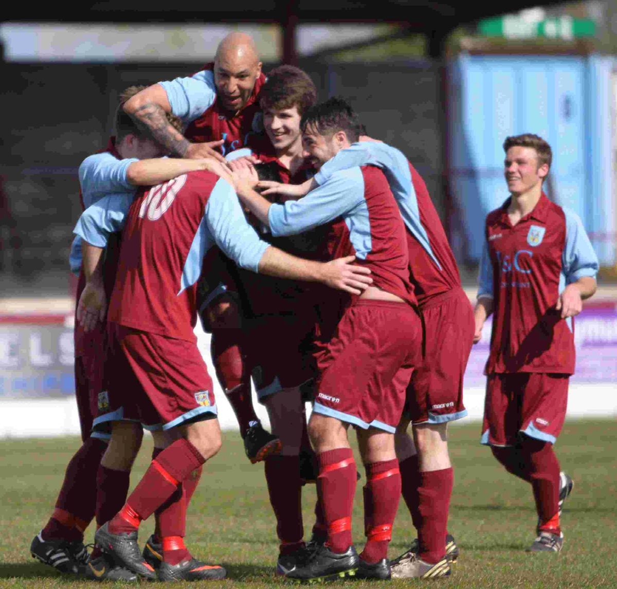 CLASSY CARL: Carl McClements is mobbed by his team-mates after scoring