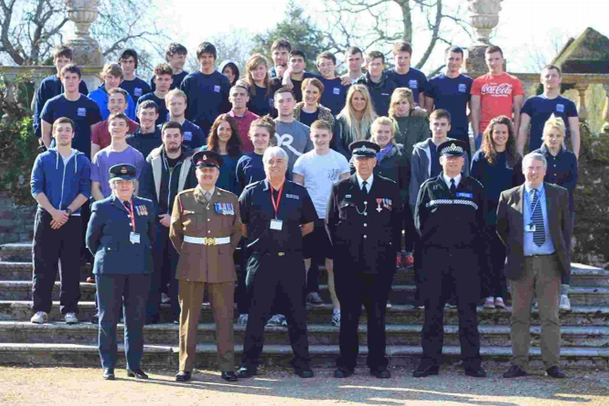 Students with Flt Lt Mary Brennan RAF, Cpl Nigel Scott RAMC TA, Station Commander Steve Cheeseman of Dorset Fire and Rescue, Special Inspector Geoff Meehan MBE of Dorset Police and Insp Mike Darkin of Dorset Police Volunteers Co-ordinator