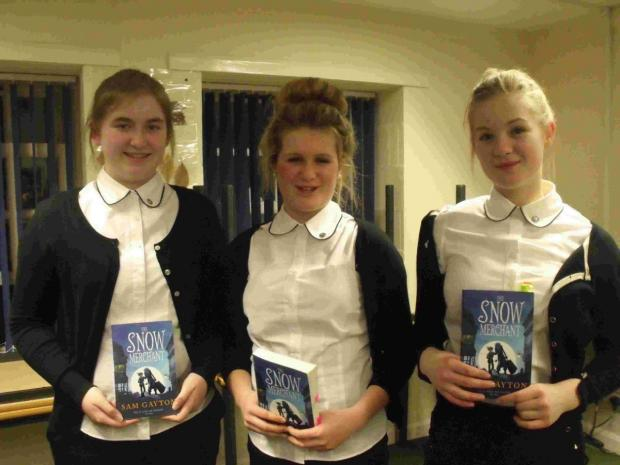 WELL READ: From left, Bethany and Josephine Mitchell and Lucy Siebert