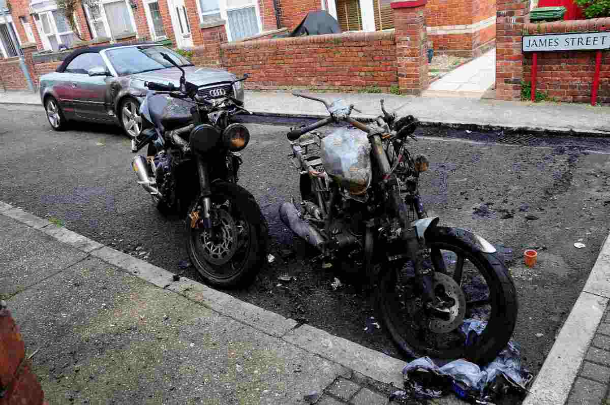 TORCHED: The burnt-out motorcycles and damaged car