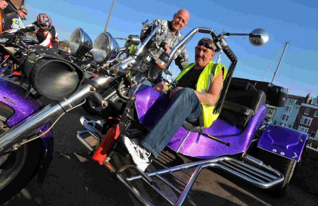 HOT SEAT: Organiser Brian Coombes sits on Roy Andrew's trike