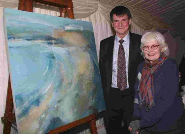 Joanna Brendon presents her painting to Stephen Remington retiring chief executive of Action for Blind