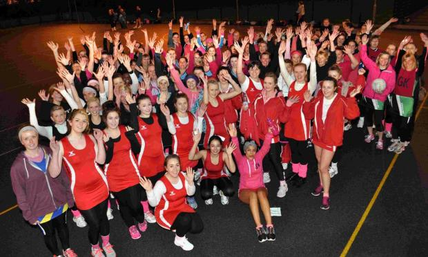 HANDS UP: The South & West Dorset netballers raising money for Cancer Research