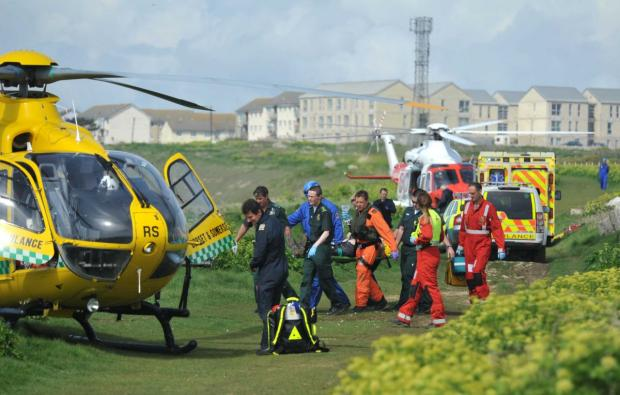 RESCUE: The casualty is carried to the air ambulance. Picture: DORSET MEDIA SERVICE