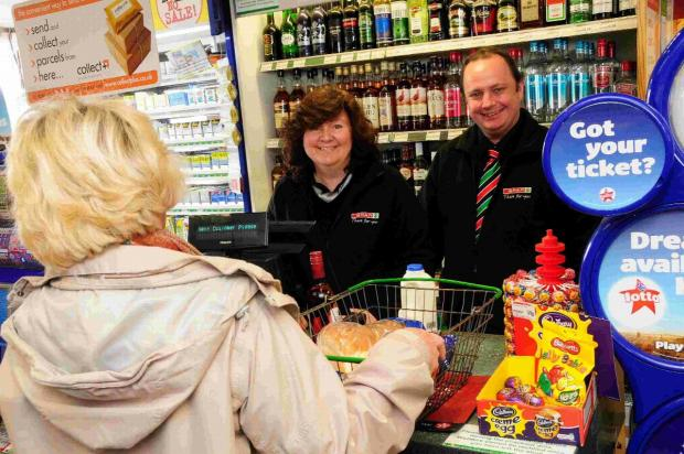 Staff members Debbie Sharp and James Felton at the checkout