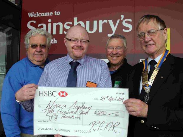 CHEQUE IN: Ian Spofforth, Sainsbury's manager Steve Jones, Ian Brooke and RCMR President Richard Cropper
