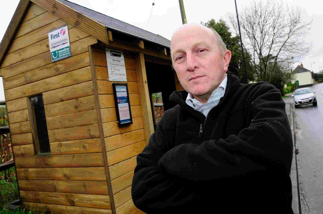 CONCERN: Andy Turner at the Orchard Meadow bus stop in Tolpuddle