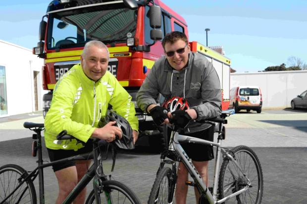 ON THEIR BIKES: John Baker and son Harry