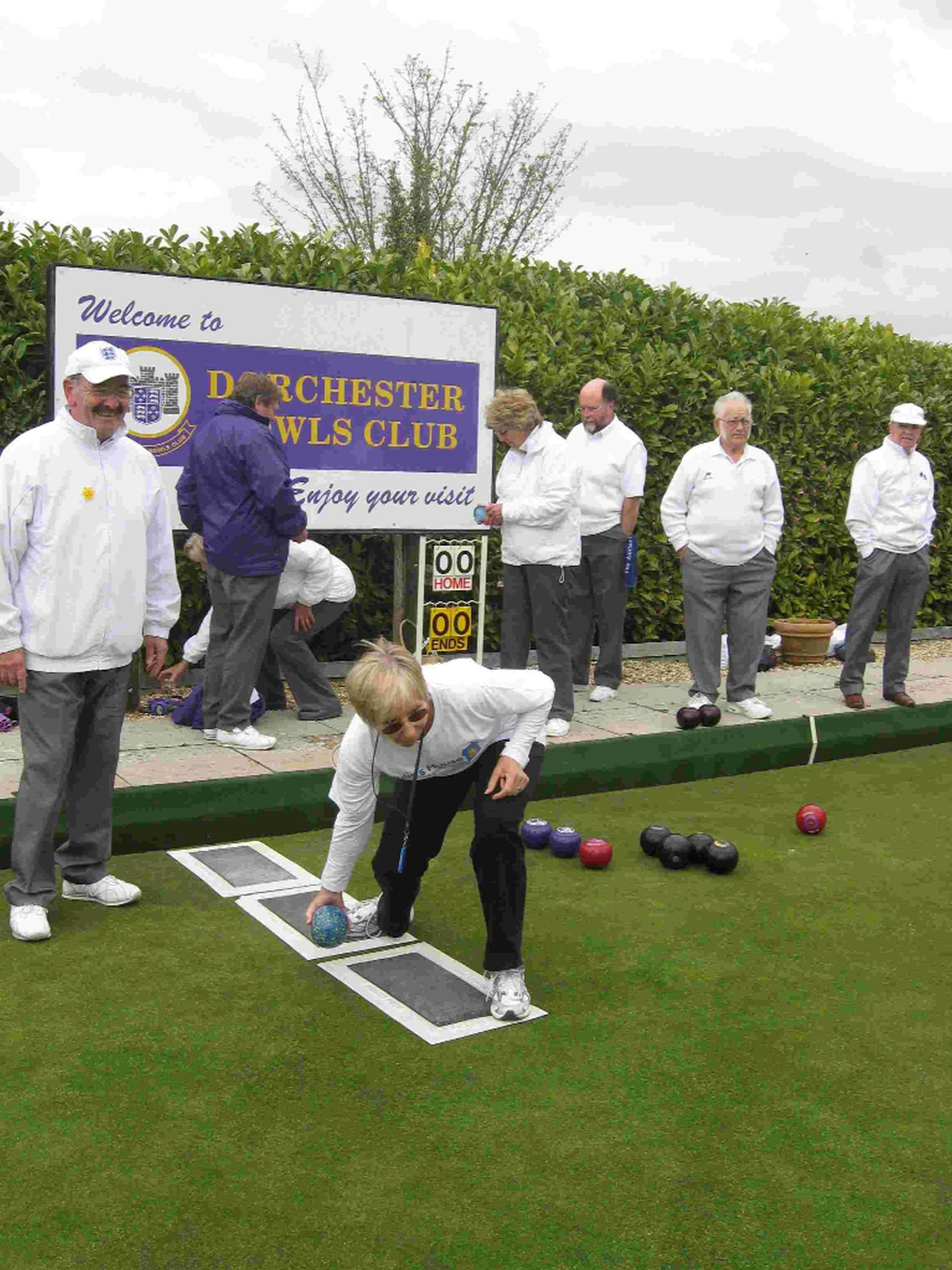 ON THE GREEN: Gill Slade bowls the first ball to open the outdoor season at Dorchester