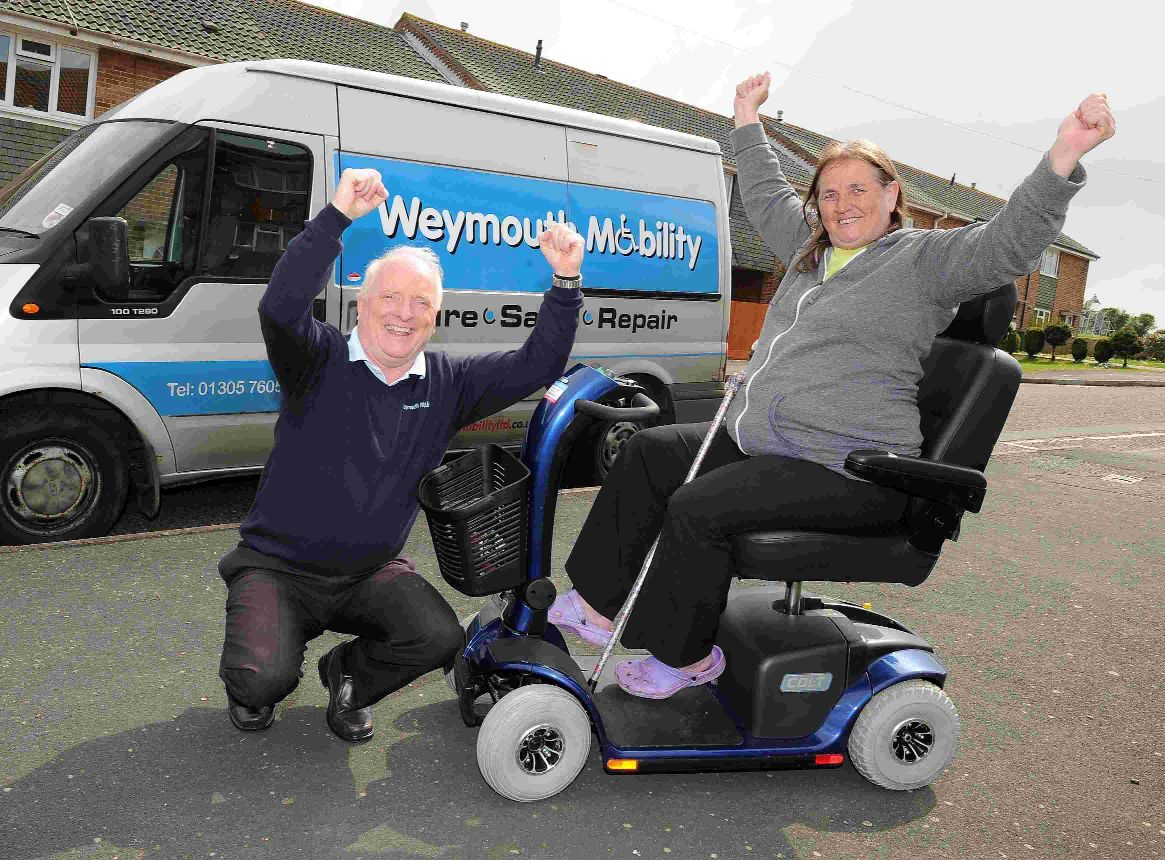 WHEELY HAPPY: Susan Read, whose mobility scooter was stolen and burned, is loaned a scooter by James Monahan from Weymouth Mobility