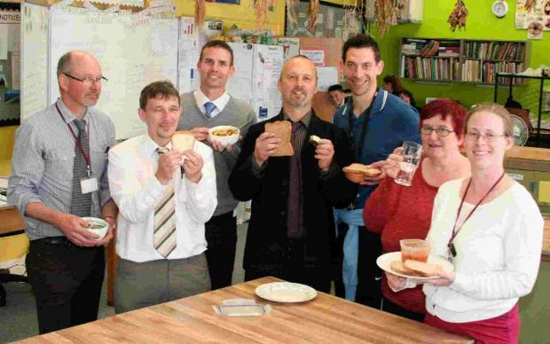 BELOW THE LINE: Head of art Brian Smith, centre, with other teachers at All Saints School, Weymouth, with their lunches