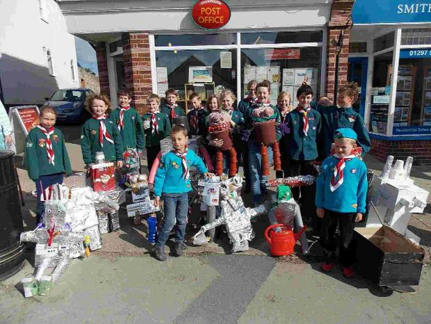 DOING OUR BIT: Charmouth scouts who built robots and raised £180. Right,  Legh House residential home staff and friends doing a spons