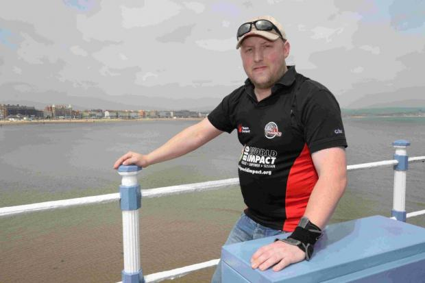 Dorset Echo: INTREPID: Gus McKechnie is taking on the cycle section of Challenge Weymouth in a racing wheelchair