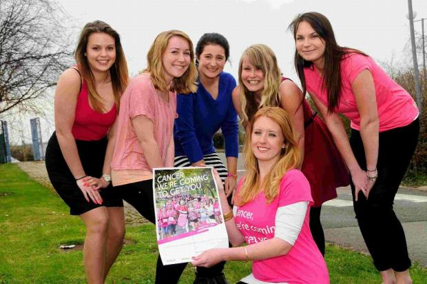 RARING TO GO: Race For Life members, from left, Emily Woodgate, Rebecca Brown, Catherine Bolado, Tara Cox, Teri Dyer and Emma Walker holding poster