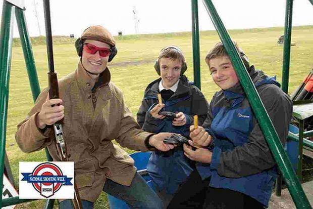 TARGET SET: Dorchester's Olympic double trap gold medallist Peter Wilson instructs youngsters at last year's event