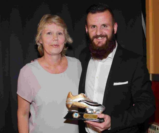 HOT-SHOT: Sponsor Linda Nash gives top scorer Stewart Yetton the golden boot