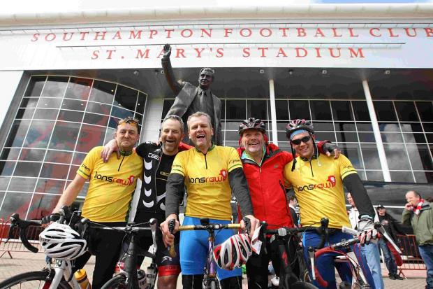 WE DID IT: Seamus Bowerman-Ellis, Jim Bowerman, Andy Bowerman, charity founder John Burns and Josh Bowerman at St Mary's Stadium, Southampton