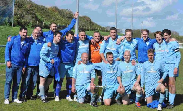 Dorset Echo: CHAMPIONS: Dolphin celebrate their cup final win