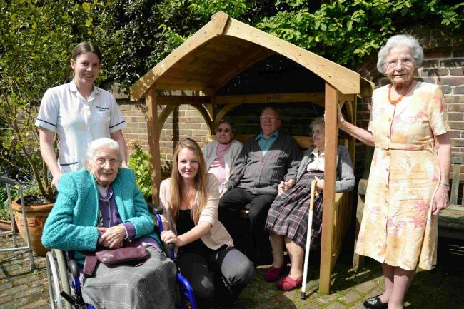SUCCESS: Grassington House Care Home Manager Megan Read (centre) and Helen Dawe chat with resident Peggy Wyatt in the garden