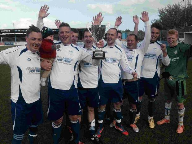 CHAMPIONS: Portland Town B's Craig Wells, Paul Cole, Peter Hoare, Mike O'Donovan, Ben White, Chris Ginifer, Kieren Epsley, Floyd Musson and Richie Copp lift the Ricol Leisure Cup at the Bob Lucas Stadium