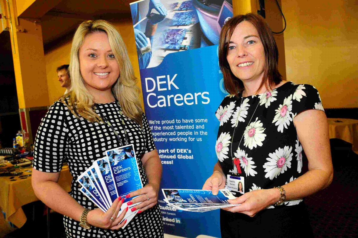 HELPING HAND: Charlotte Hibbs and Sandra Hartnell on the DEK stand