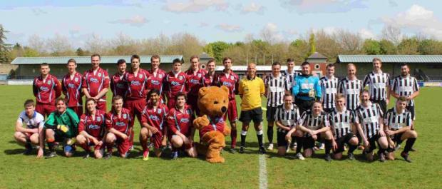 Dorset Echo: MATCH OF THE DAY: Clinicians, left, v Porters line-up before Dorset County Hospital's annual charity football match