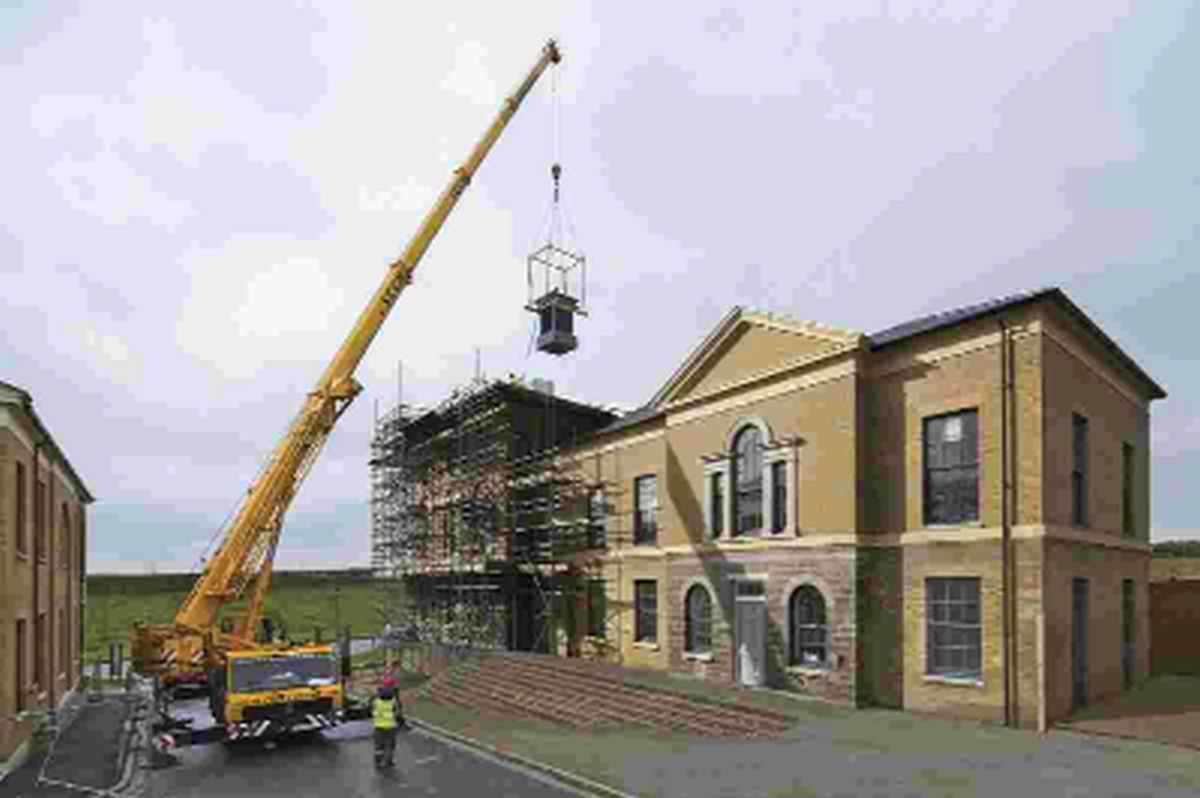 Cupola being lifted into place at Corston House, Poundbury