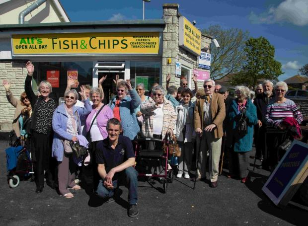 Dorset Echo: OFF WE GO! John Pearce from Alf's Fish and Chips shop, front, with pensioners about to leave on the day trip to Blue Ball