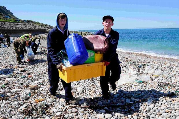 HARD WORK: Youngsters clear rubbish from Chesil Cove