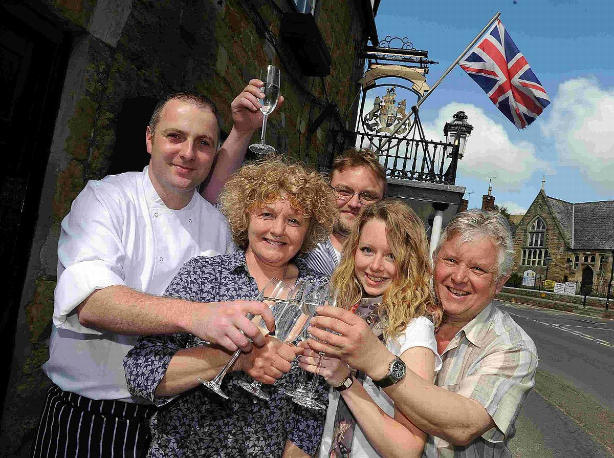 BACK IN BUSINESS: Celebrating the reopening of the Ilchester Arms Hotel are Sean McBride, head chef, and owners Cathy, Tom, Sarah and Geoff Harrison