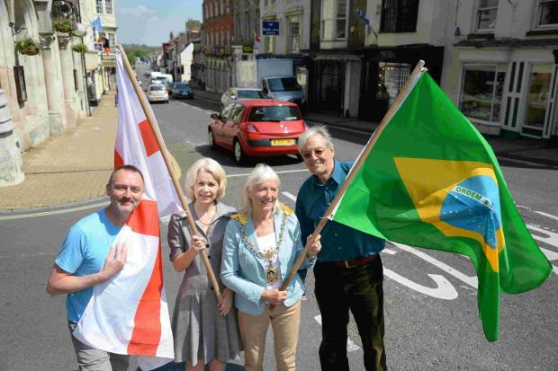 Dorset Echo: IN PLACE: Dorchester flags go up, from left David Taylor, Sian Merriott, Stella Jones and Alistair Chisholm