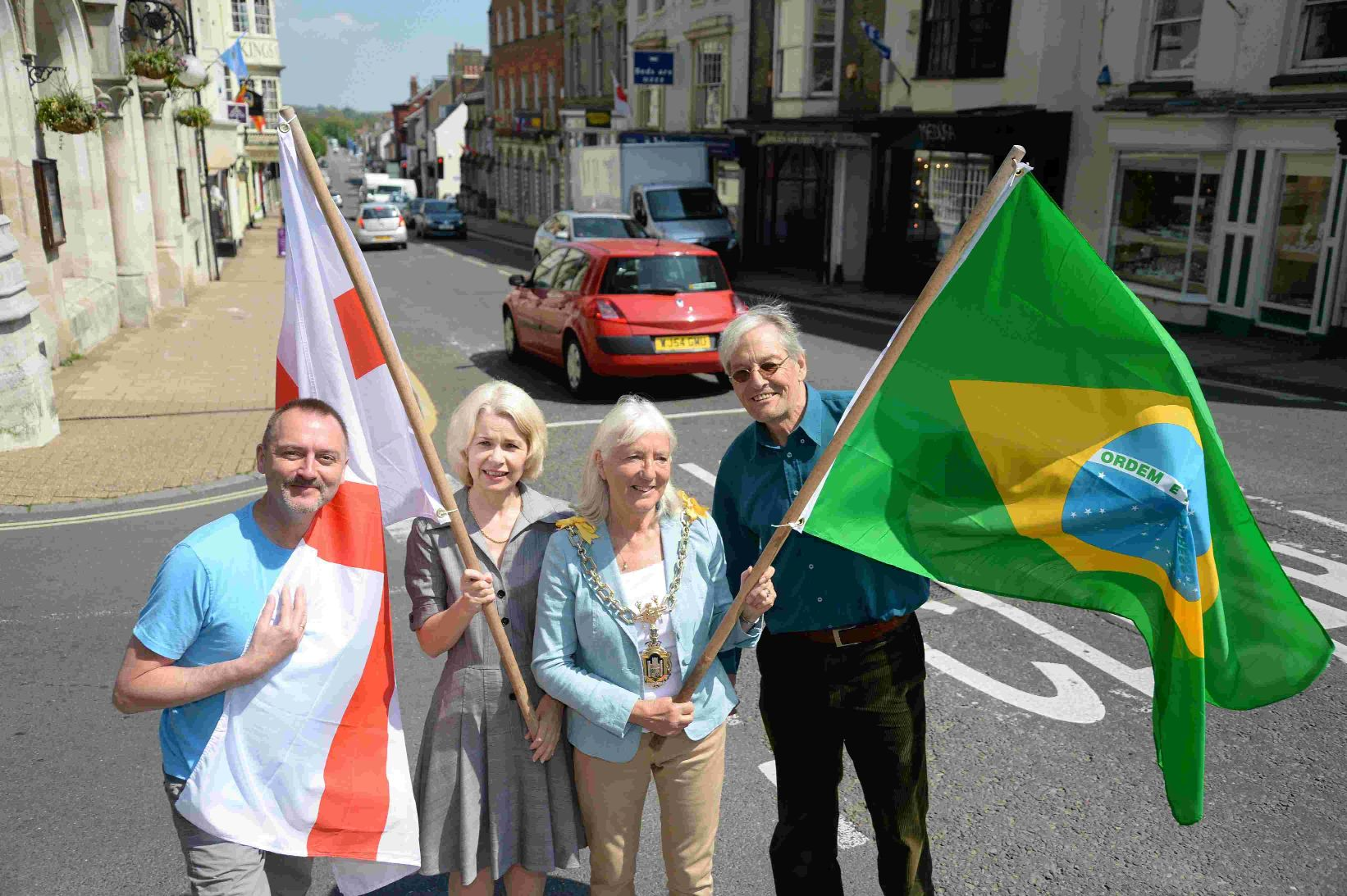 IN PLACE: Dorchester flags go up, from left David Taylor, Sian Merriott, Stella Jones and Alistair Chisholm