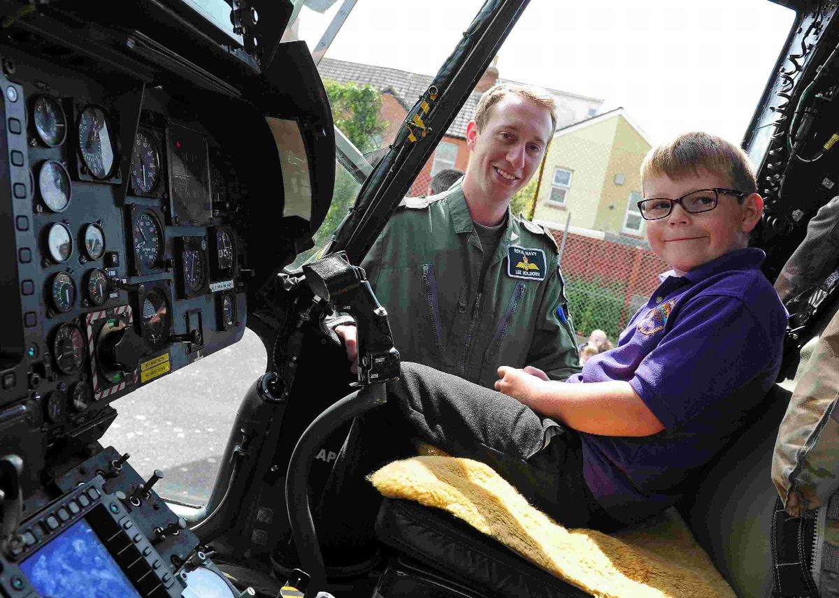 IN THE HOT SEAT:  Lt. Lee Holborn shows Thomas Bradshaw the controls