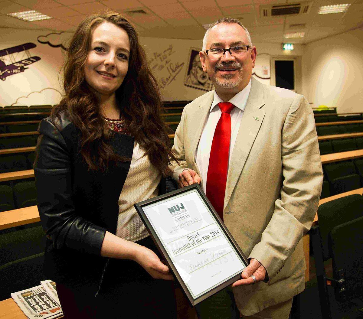 ACCOLADE: Samantha  receives her award from Adam Christie, NUJ president