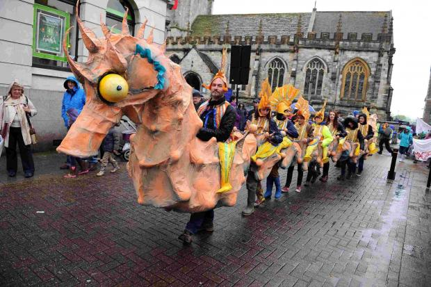 Dorset Echo: Dorchester streets brought to life in festival parade. Picture: FINNBARR WEBSTER