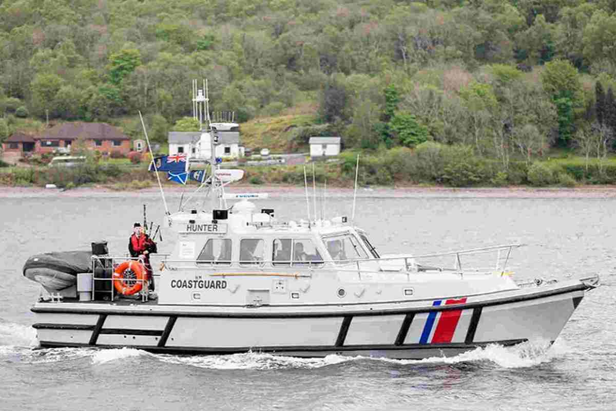 FULL SPEED AHEAD: Karl Wainwright with the pipes on board an Oban Coastguard cutter near Fort William