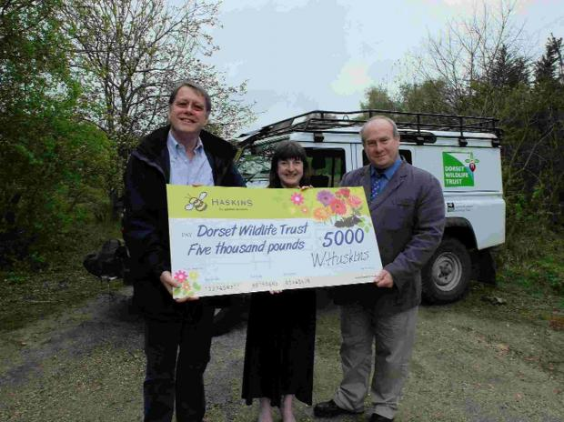 THANK YOU: Cheque presentation with Warren Haskins, DWT urban and east manager Nicki Brunt and DWT director of operations Brian Bleese