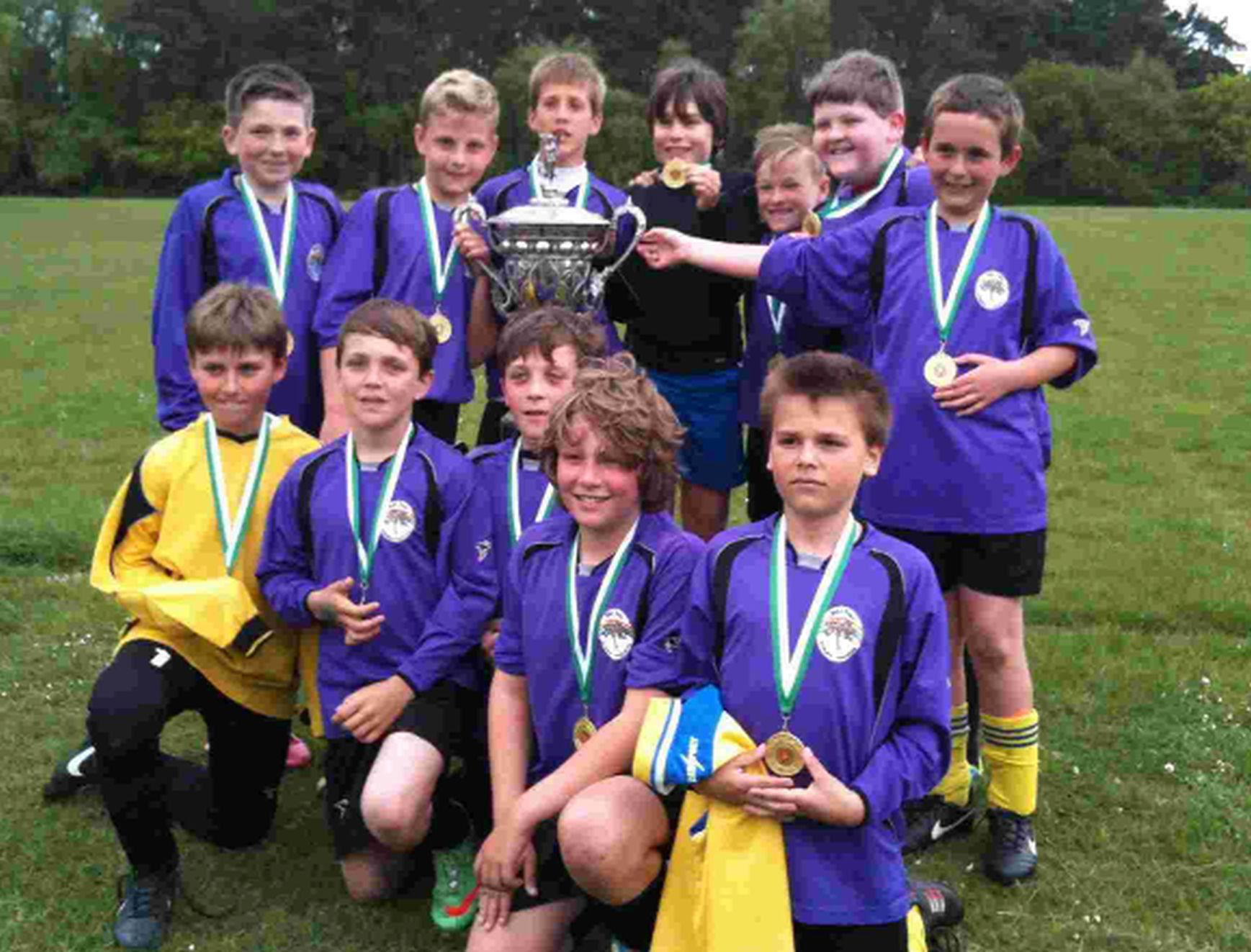 JUNIOR JOY: The Wyke Regis team show off the county cup